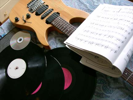 records, guitar and sheet music